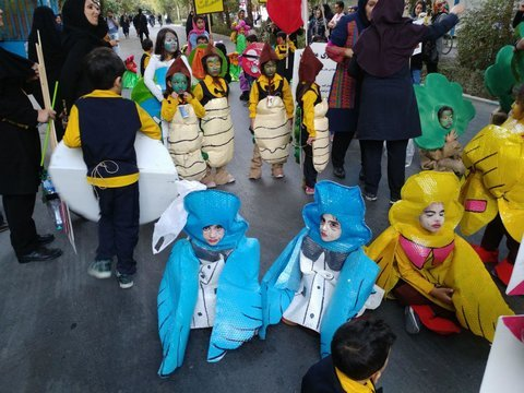Children on environmental parade on car-free Chahar-Bagh Ave