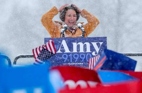 U.S. Senator Amy Klobuchar brushes snow from her hair after announcing her candidacy for the 2020 Democratic presidential nomination in Minneapolis.