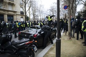 Gilets jaunes protesters attack a luxury car