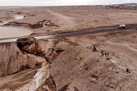 An aerial view of a flooded area near the Chuquicamata mine, the largest open-air copper deposit in the world. The state-owned mining company Codelco suspended operations due to heavy rains