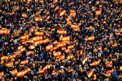 Rightwing protesters wave Spanish flags during a demonstration against the Spanish prime minister Pedro Sánchez. The conservative Popular party (PP), centre-right Ciudadanos and far-right Vox have all called on their supporters to take to the streets of Madrid against Sánchez after accusing him of making concessions to Catalan separatists