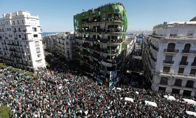 People gather during a protest over President Abdelaziz Bouteflika's decision to postpone elections and extend his fourth term in office.
