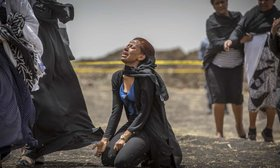 Relatives of crash victims mourn and grieve at the scene where the Ethiopian Airlines Boeing 737 Max 8 crashed shortly after takeoff, killing all 157 on board.