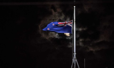 The national flag of New Zealand is flown at half-mast on a parliament building after the shooting incident in Christchurch.