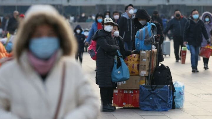 More cities locking down in China over virus outbreak fears