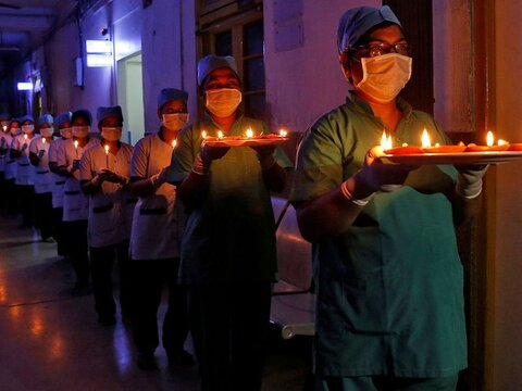 India observes nationwide candlelight vigil in a show of solidarity in the fight against coronavirus